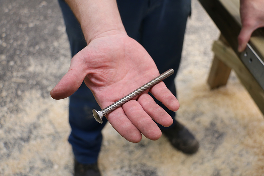 Make sure the metal work is straight and pass this M8 120 mm bolt into the hole closest to the top of the gate.