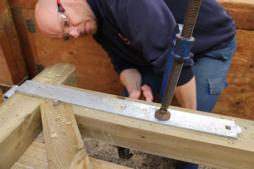 The use of a hammer ensures the bolt passes right through and stands proud of the wood.